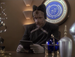 Sisko proposes security measures to the president, who reluctantly agrees