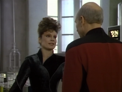Picard challenges Ardra to fight him in court, to prove her case.