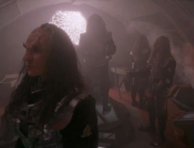 Kira knew how to beam the klingons onto the cardassian ship
