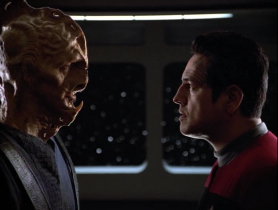 The alien tells Chakotay to go to a certain star system, past their space, and then they'll be safe