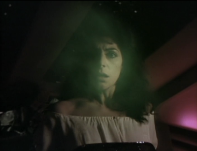 A green cloud goes into Troi and gives her a weird voice