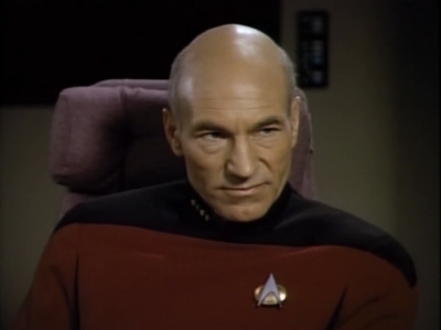 Picard doesn't think her tricks are that cool. He's not willing to let the planet fall under her rule