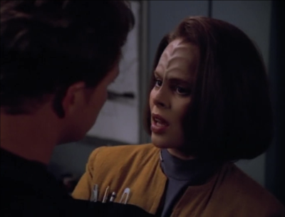 B'Elanna is wearing her weird engineering coat where she keeps her pens