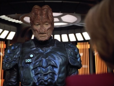They help the Hirogen, and and then ask him for a hand in catching the 8472 guy