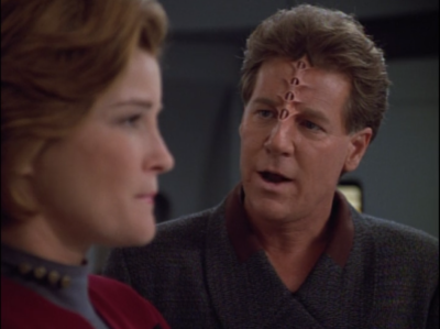 Janeway negotiates with an arms dealer to get some better weapons