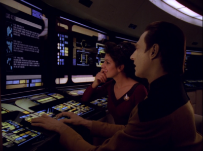 Troi and Data figure out that the aliens want to collaborate to make an explosion, and that would free their ships