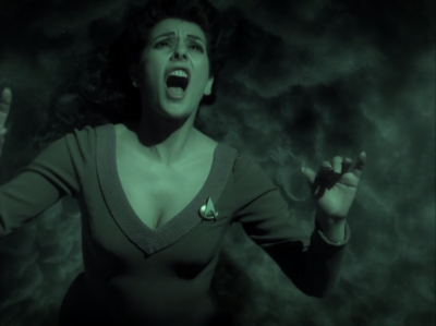 Troi goes to sleep to yell at the aliens to do the thing