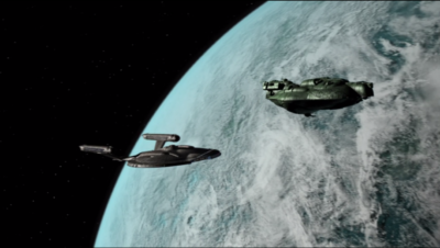 The Orion captain comes back and starts towing Enterprise away