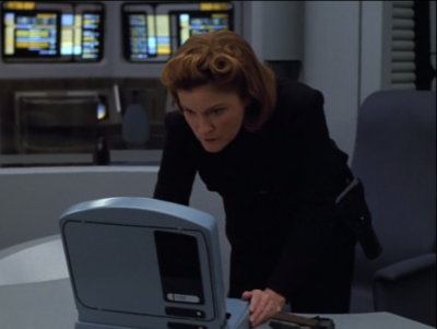 Janeway finds a way to disable the mind controlers