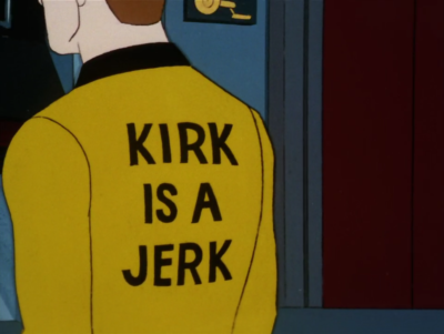 Kirk explains that after washing one of his uniforms, he discovered this written on the back, but then I guess he still put it on and went to show everyone