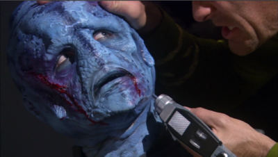 One of the prisoners says their's a Gorn still on the ship