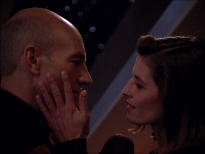 Picard is giving a speech to archaeologists, and Vash shows up!