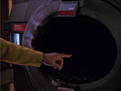 Geordi points at a thing to show that the sabotage was just a malfunction