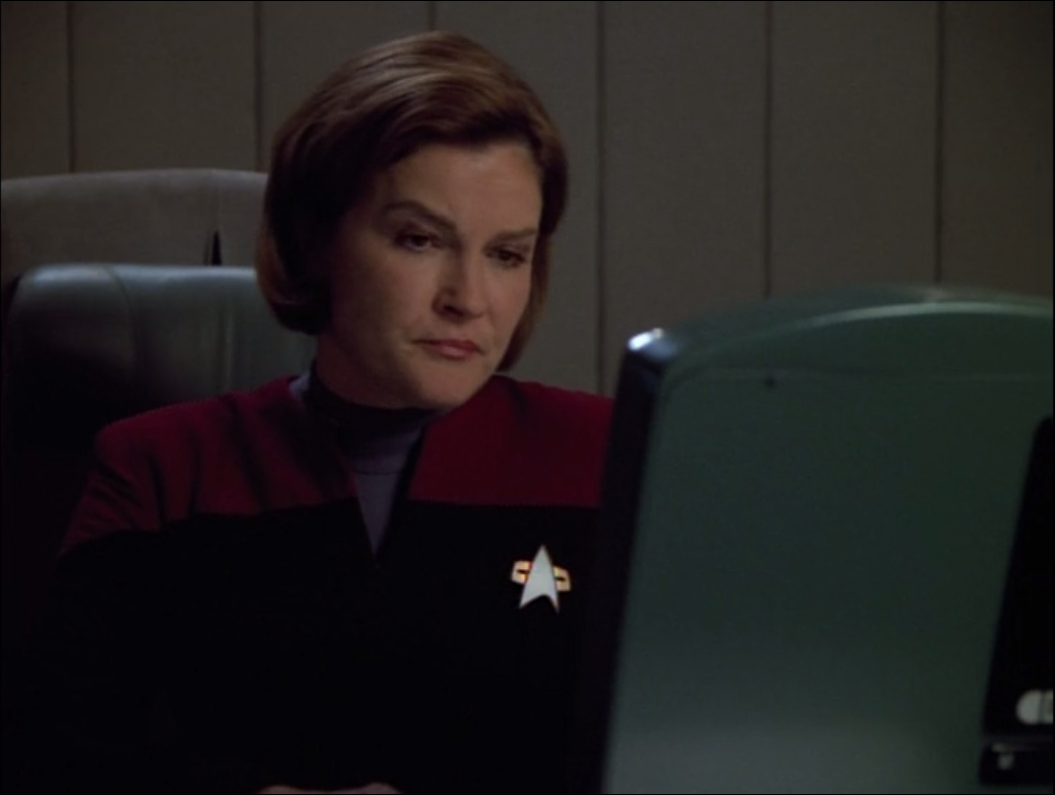 Janeway is being super secretive about something called the Omega Directive, which is apparently issued to all the top level Starfleet people