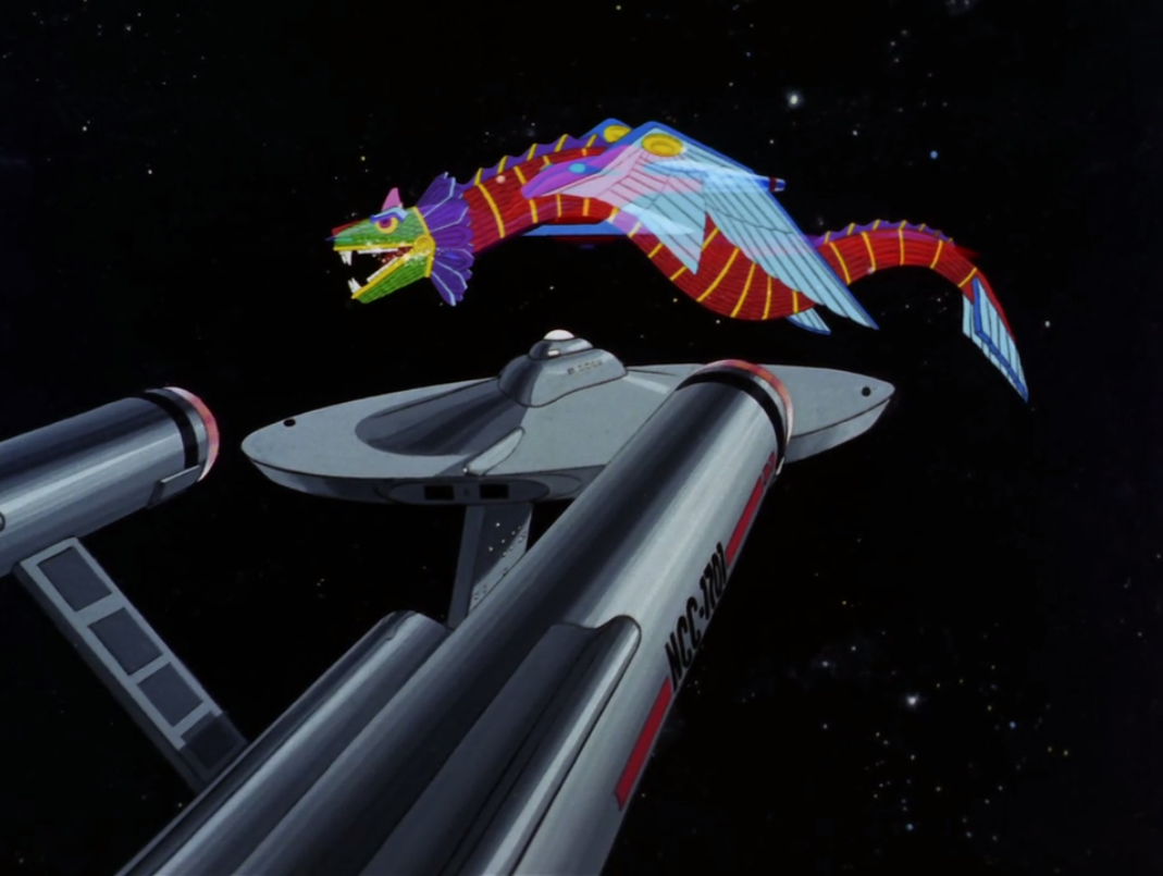 Meanwhile Enterprise breaks free of the bubble and starts firing of Kukulkan's ship