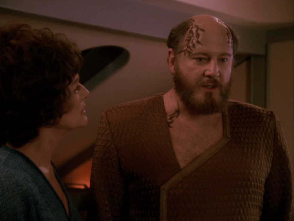 Lwaxana argues with him about his world's traditions. He's specially capable of saving his world, so he really needs to stick around for a bit longer
