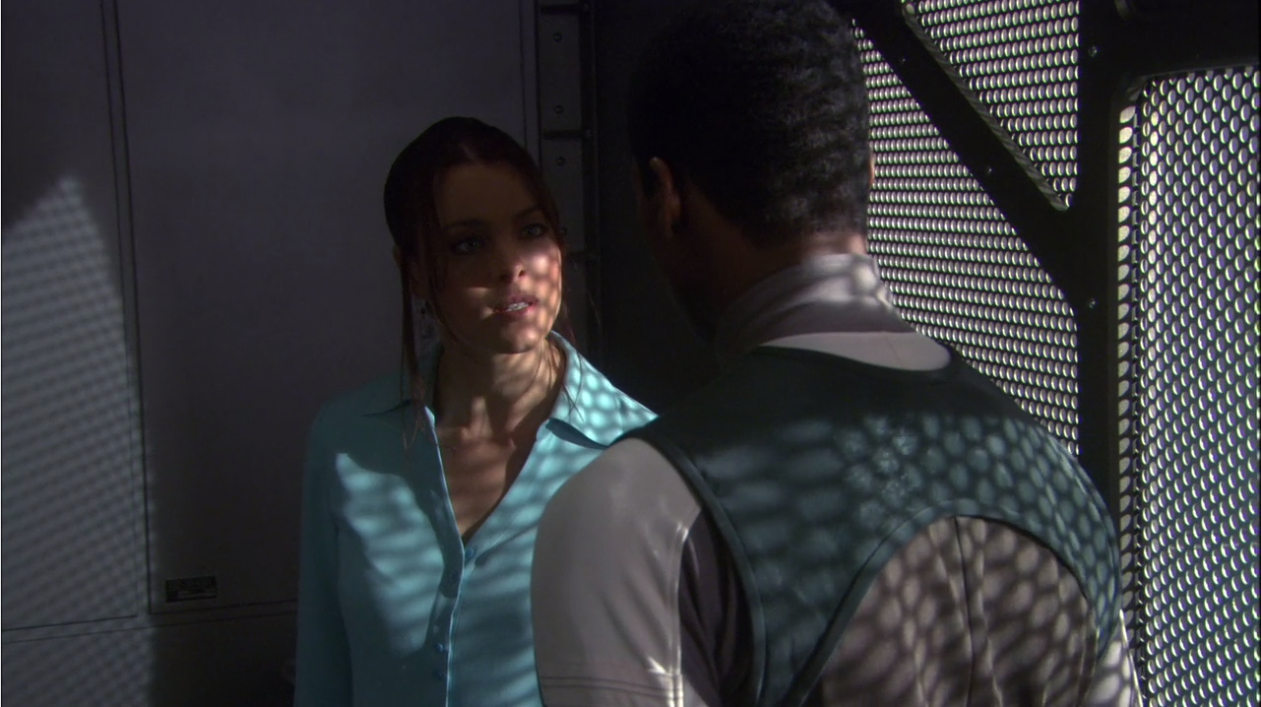 Travis's old girlfriend warns him that there's still a spy out there because seriously she's not a spy for Terra Prime